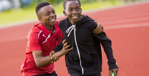 Two boys celebrating after a relay