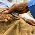 Older person's hand being held