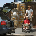 Car and person in wheelchair