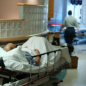 Man in bed in hospital