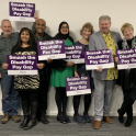 UNISON members with signs saying 'Smash the disability pay gap'